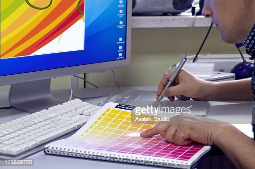 Graphic designer selects the color of the color swatch