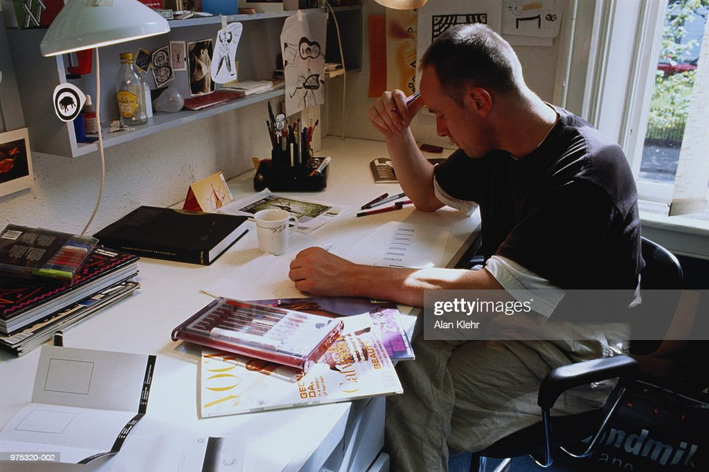 Graphic designer working at desk, close-up : Stock Photo