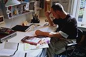 Graphic designer working at desk, close-up