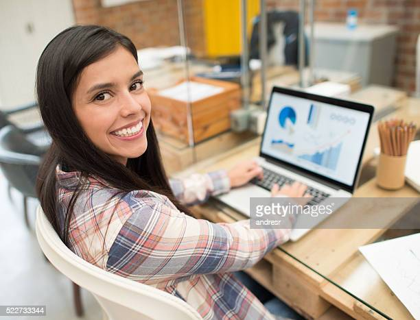 Graphic designer working online at the office