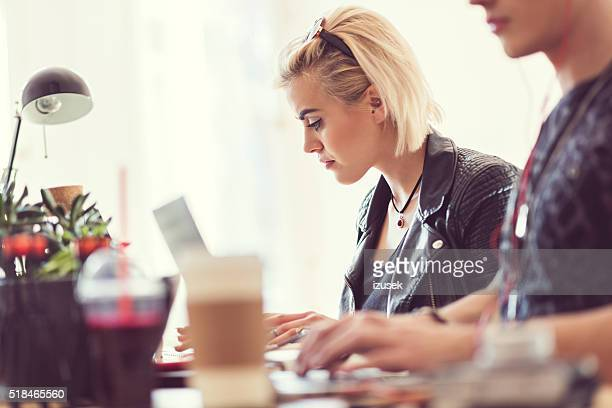 Graphic designers at work, focus on blonde woman