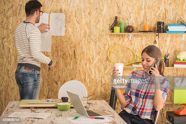 Graphic designers working at office