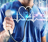 Doctor with stethoscope and graphic heartbeat background