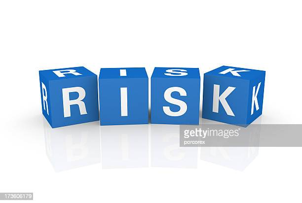 Graphic of four blue cubes with white letters spelling RISK