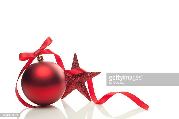 Graphic of red Christmas ornament, ribbon and star