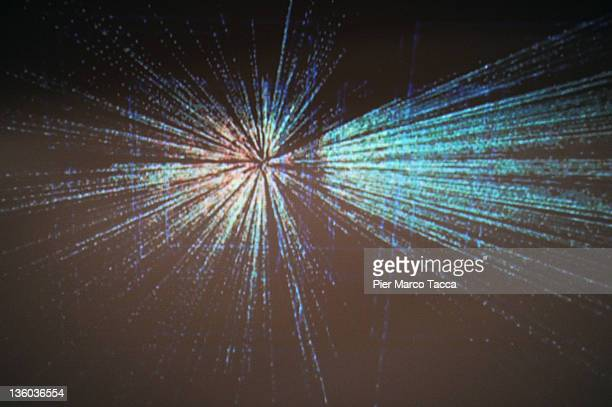 A graphic projected onto a screen shows traces of collision of particles during the Large Hadron Collider Conference at Museo della Scienza e della...