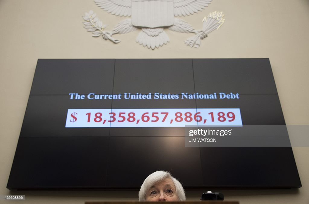 A graphic shows the rising current US national debt as Federal Reserve Chair Janet Yellen testifies before the House Financial Services Committee on...