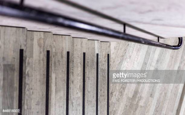 - graphic wooden steps, stripes, iron steel pipe railing and concrete background -