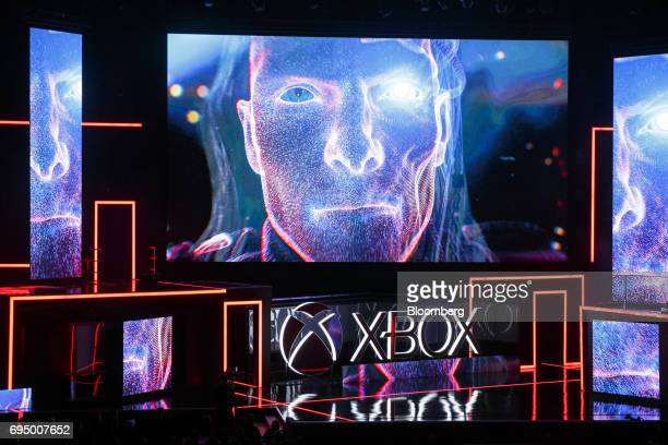 Graphics are displayed on screens at the start of the Microsoft Corp Xbox One X reveal event ahead of the E3 Electronic Entertainment Expo in Los...