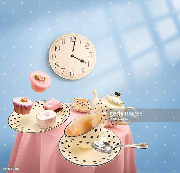 Graphics of tea-time with mugs and cakes flying off table
