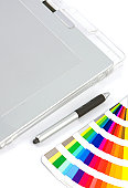 Graphics Tablet, Pen And Colour Chart, overhead view on white