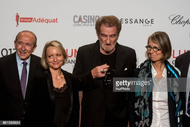 Gérard Collomb Minister of Interior Eddy Mitchell and Françoise Nyssen Minister of Culture poses in front of the photographers when they arrives at...