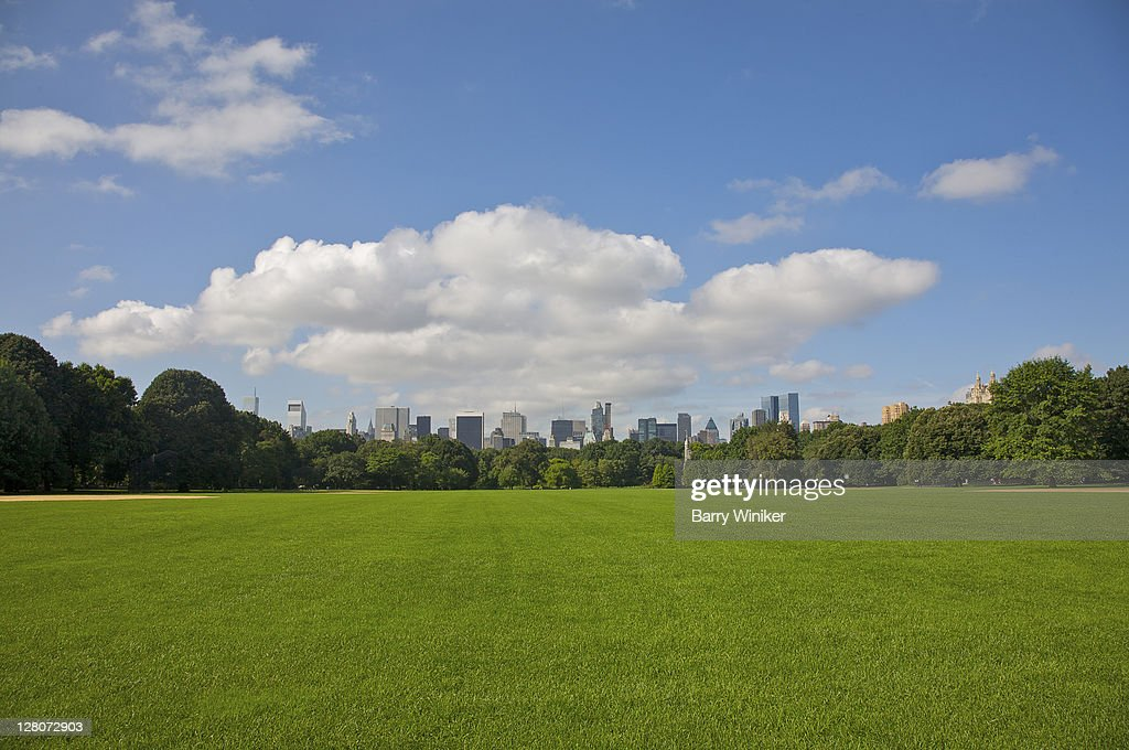 Grass and baseball diamond, looking south towards Midtown, from Central Park, New York, NY, U.S.A. : Stock Photo