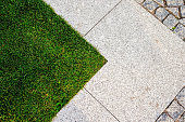 Copyspace with green grass and stone pavement