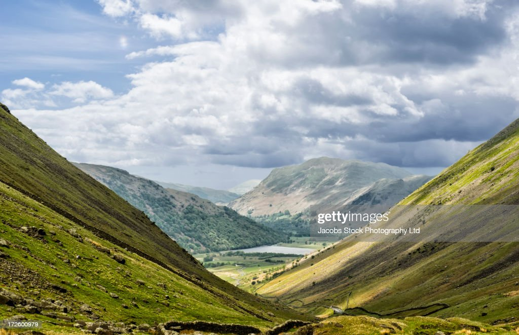 Grass growing in rural valley : Stock Photo