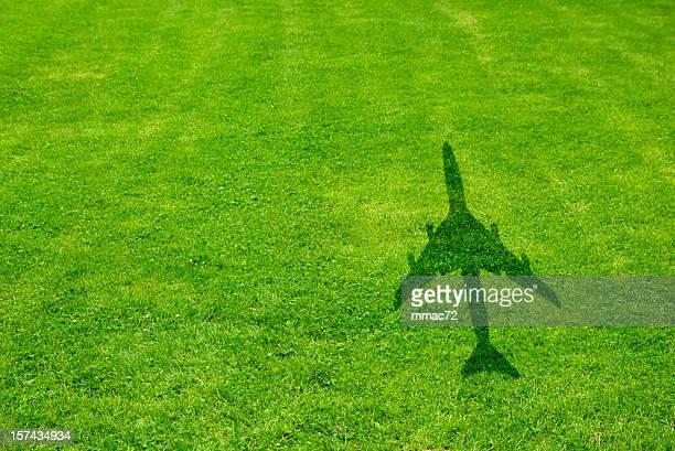 Herbe avec avion ombre