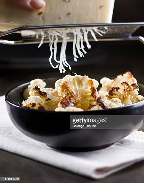 Grated Asiago cheese boosts the flavor of roasted cauliflower