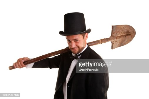 Grave Digger with dirty spade : Stock Photo