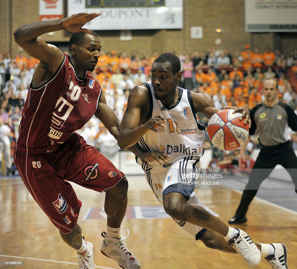 Gravelines' French shooting guard Yannick Bokolo (R) vies with Cholet's Nigerian guard Michael Efevberha during the second leg of the French ProA basket-ball semi-final Gravelines vs. Cholet on June 2, 2010 at the Sportica sports center in the French northern city of Gravelines. Cholet won 83-73.