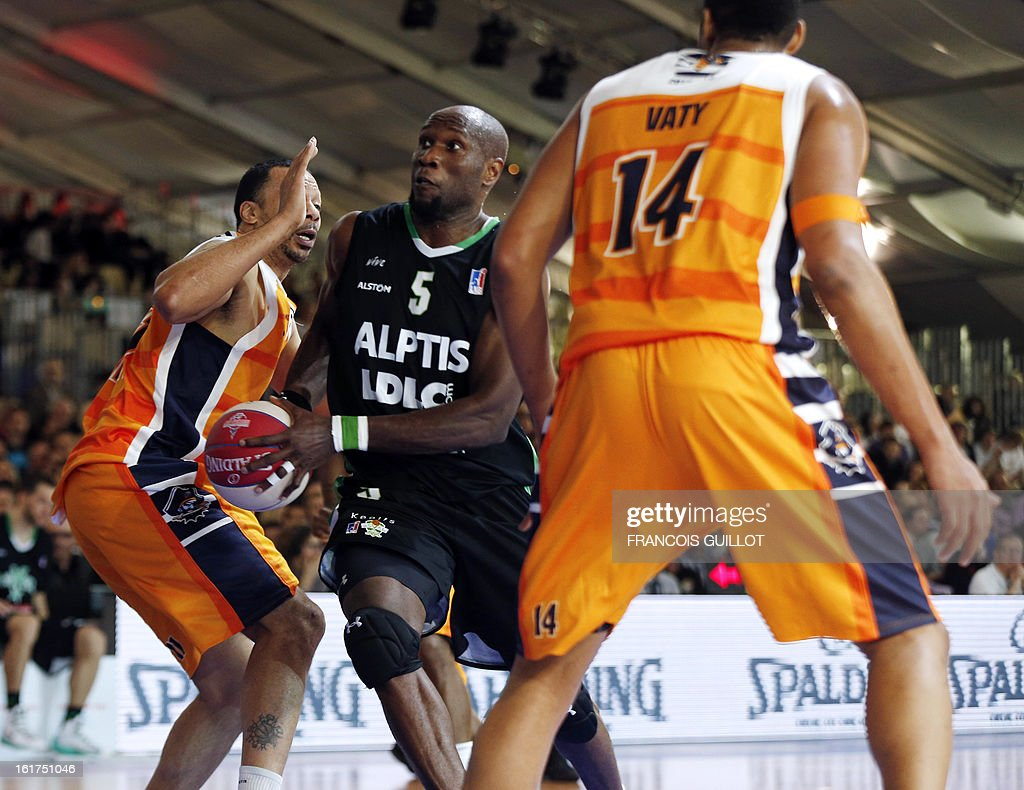 BCM Gravelines-Dunkerque player Ludovic Vaty (R), and Kennedy Winston (L), vies with ASVEL Lyon-Villeurbanne player Uche Nsonwu-Amadi (C), during the leaders cup LNB 2013 tournament basketball quarter final match on February, 15, 2013 held at Disneyland Paris at Marne-la-Vallee near Paris.