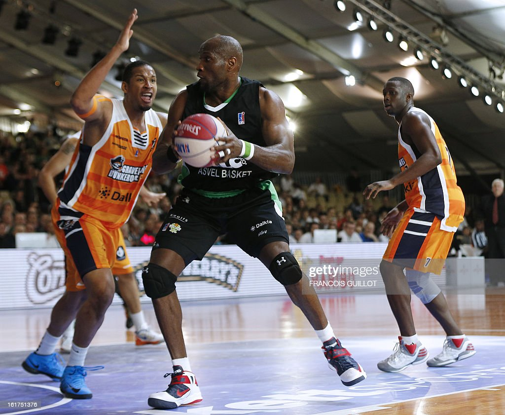 BCM Gravelines-Dunkerque player Ludovic Vaty (L), vies with ASVEL Lyon-Villeurbanne player Uche Nsonwu-Amadi (C), during the leaders cup LNB 2013 tournament basketball quarter final match on February, 15, 2013 held at Disneyland Paris at Marne-la-Vallee near Paris.