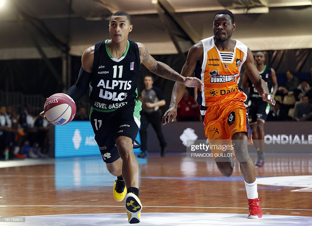 BCM Gravelines-Dunkerque's Yannick Bokolo (R), vies with ASVEL Lyon-Villeurbanne's Edwin Jackson (L) during the leaders cup LNB 2013 tournament basketball quarter final match on February, 15, 2013 held at Disneyland Paris at Marne-la-Vallee near Paris.