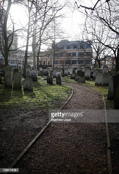 Graves and tombstones in the Bunhill Fields cemetery which has been awarded Grade 1 listed status on February 24 2011 in Islington London England The...