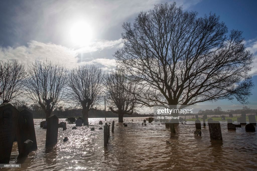 Graves are surrounded by floodwater at St Deny's Church on February 13, 2014 in Severn Stoke, Worcestershire, England. The Environment Agency has issued flood warnings for dozens of areas along the River Severn.