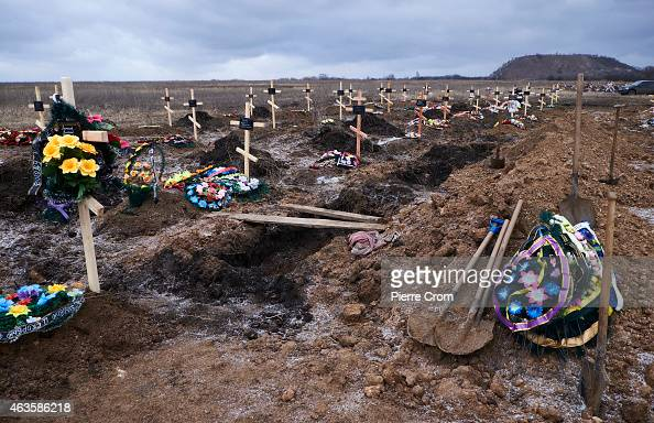 Graves in the cemetery of Mospyne during the funeral of four rebel fighters killed on the frontline on February 16 2015 in Mospyne Ukraine The rebels...