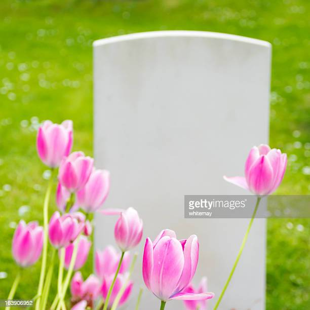 Gravestone and tulips