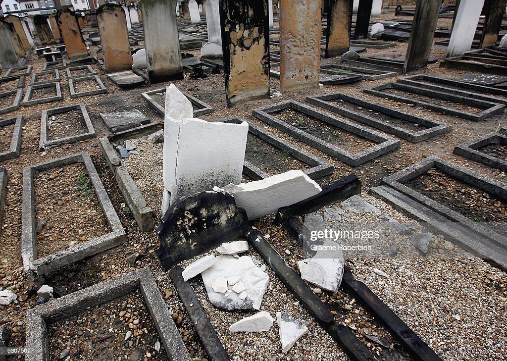 Gravestones lay desecrated in Eastham Jewish cemetery June 16 in London England AntiSemitic vandals have damaged gravestones and painted graffiti in...