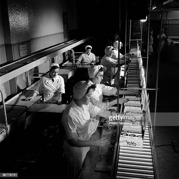 A gravity conveyor packer 1957 at the factory of George Macdonald who produced the popular biscuits Photograph by Walter Nurnberg who transformed...