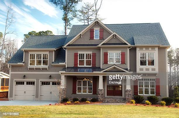 A gray accented suburban home with a double garage