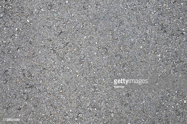 Gray asphalt with crystals and diamonds imbedded