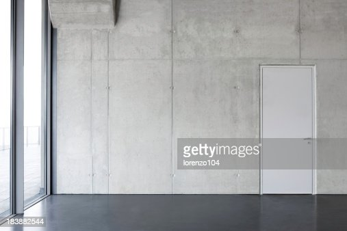 concrete wall with a door.