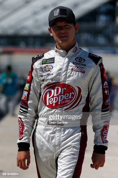 Gray Gaulding driver of the Addiction Campuses Toyota stands on the grid during qualifying for the Monster Energy NASCAR Cup Series AAA 400 Drive for...