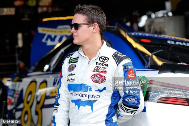 Gray Gaulding driver of the Champion Machinery Toyota stands in the garage area during practice for the Monster Energy NASCAR Cup Series Bojangles'...