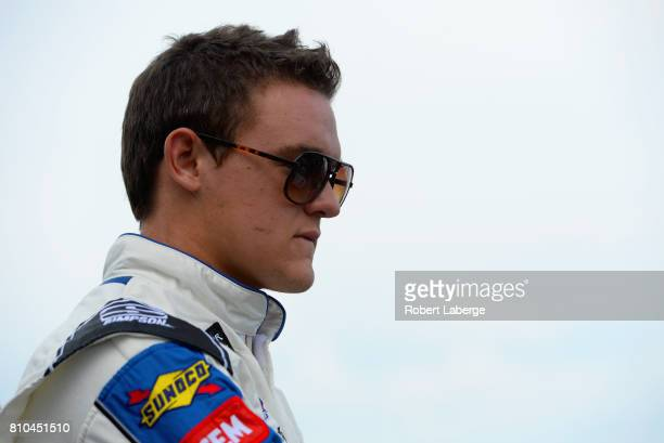 Gray Gaulding driver of the #Checkit4Andretti Toyota stands on the grid during qualifying for the Monster Energy NASCAR Cup Series Quaker State 400...