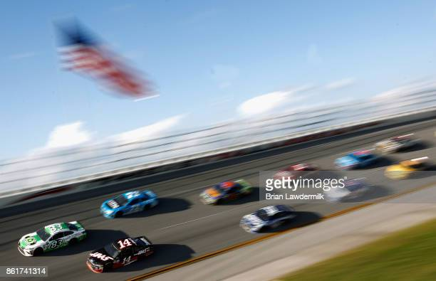 Gray Gaulding driver of the Dustless Blasting Toyota leads a pack of cars during the Monster Energy NASCAR Cup Series Alabama 500 at Talladega...