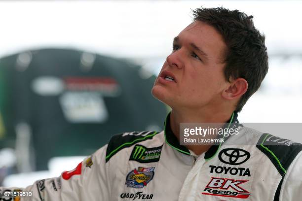 Gray Gaulding driver of the SunFrogcom Toyota stands in the garage area during practice for the Monster Energy NASCAR Cup Series Food City 500 at...