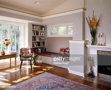 Gray Hardwood Living Room With Built In Bench And Bookshelf Stock Photo