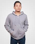 Blank sweatshirt mock up, front view, isolated. Asian male model wear plain gray hoodie mockup. Hoody design presentation. Jumper for print. Blank clothes sweat shirt sweater
