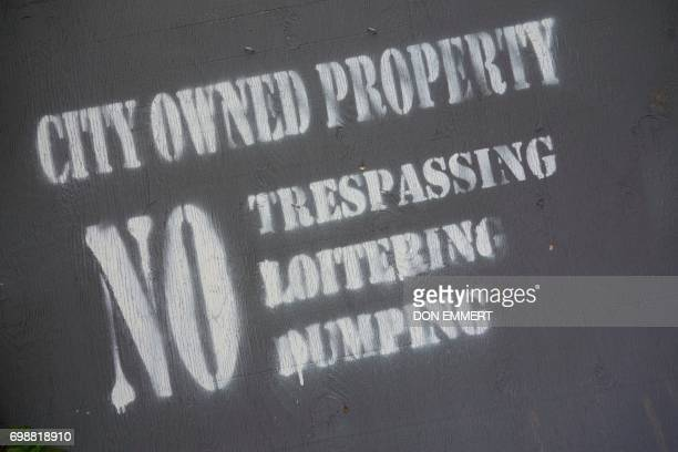 A gray sign marks a 'Zombie' property on May 30 2017 in Newburgh New York Rows of boardedup homes became a ubiquitous symbol of the US housing crash...