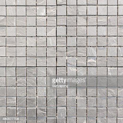 Gray tile on the wall texture and backgroud. : Stock Photo