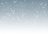horizontal shot of gray winter background with snowflakes flying all over it.winter is coming.