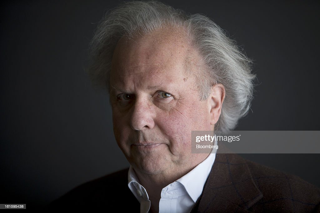 <a gi-track='captionPersonalityLinkClicked' href=/galleries/search?phrase=Graydon+Carter&family=editorial&specificpeople=605905 ng-click='$event.stopPropagation()'>Graydon Carter</a>, Vanity Fair's editor, stands for a photograph in New York, U.S., on Tuesday, Feb. 12, 2013. Carter, a Canadian-born American journalist, has served as the editor of Vanity Fair since 1992. Photographer: Scott Eells/Bloomberg via Getty Images
