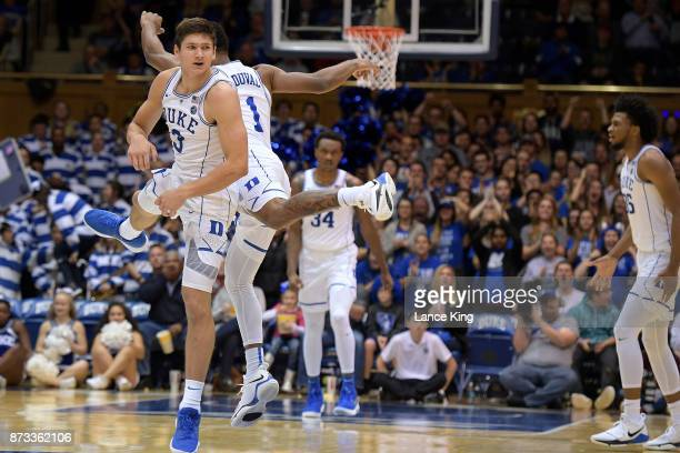 Grayson Allen and Trevon Duval of the Duke Blue Devils react during their game against the Utah Valley Wolverines at Cameron Indoor Stadium on...
