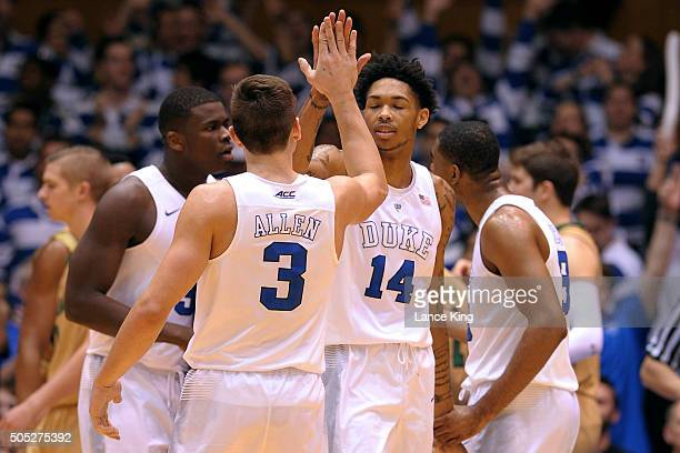 Grayson Allen highfives Brandon Ingram of the Duke Blue Devils during their game against the Notre Dame Fighting Irish at Cameron Indoor Stadium on...