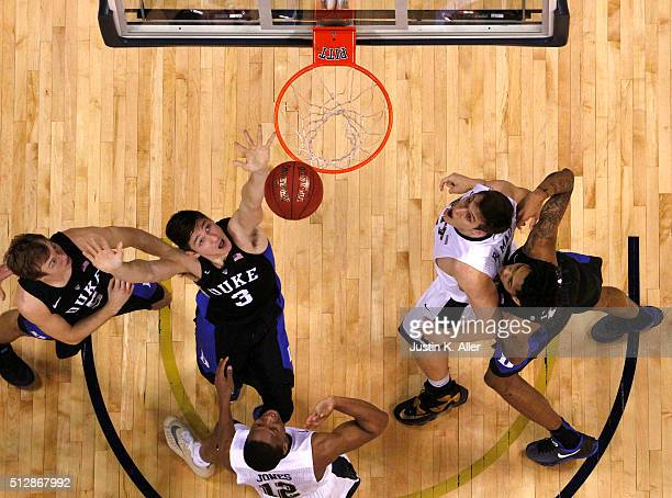 Grayson Allen of the Duke Blue Devils battles for a rebound against Rafael Maia and Chris Jones of the Pittsburgh Panthers during the game at...