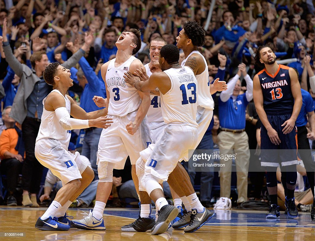 Grayson Allen of the Duke Blue Devils celebrates with teammates after scoring the gamewinning basket as time expires during their game against the...